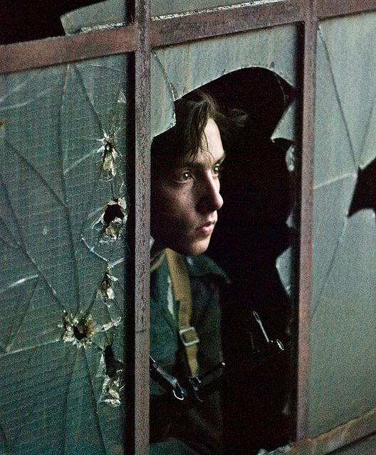 """""""Go ahead,"""" I said bitterly. """"Shoot me."""" I closed my eyes and heard the shots. Nothing hit me, and I opened my eyes. No one was there, but there were five straight bullet holes in the glass right next to my head."""