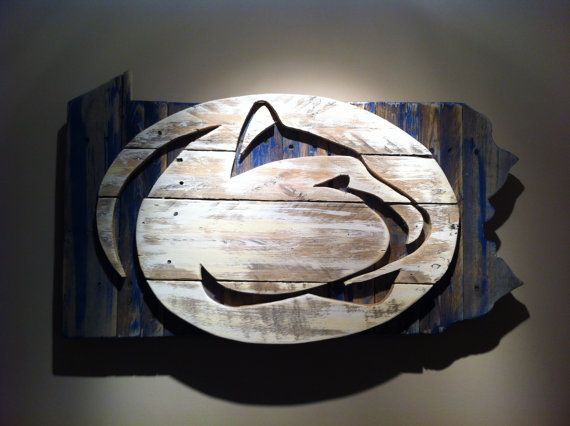 Handcrafted wooden state of Pennsylvania with Nittany Lion made from pallet wood. Dimensions are approximately 20x30 inches.    The products