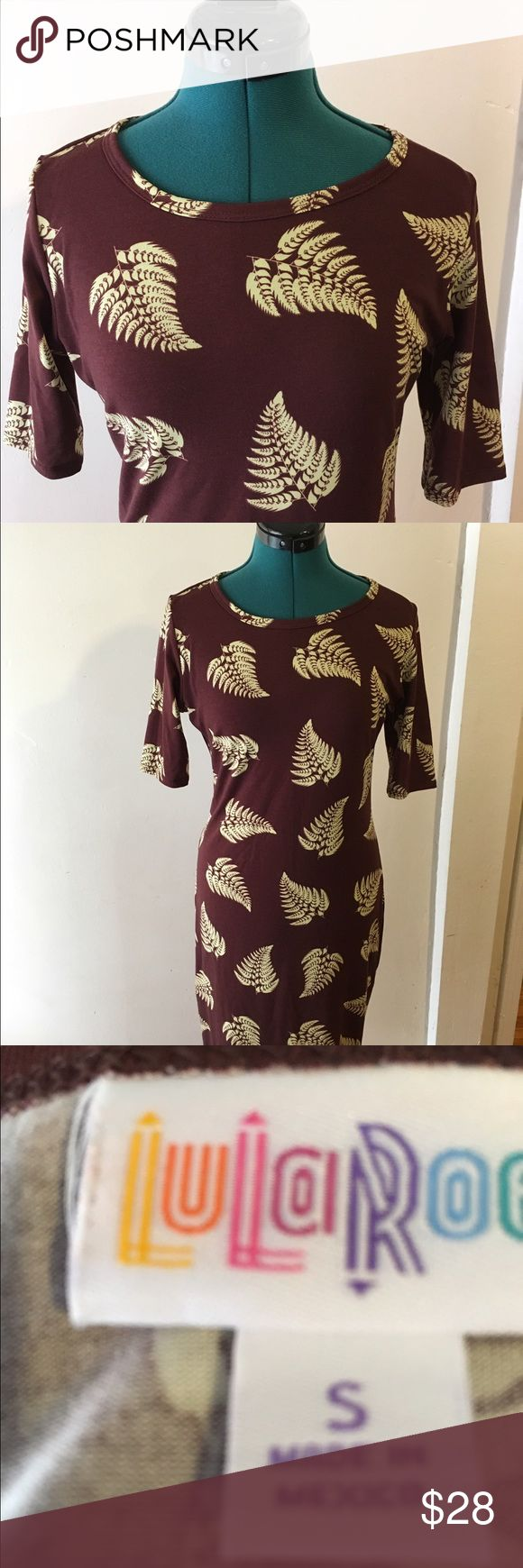 Lularoe Julia brown with leaves EUC Super cute brown Julia has light Tan fern leaves. Stretchy material brings out your green thumb! Cute with sandals or boots in the fall. LuLaRoe Dresses