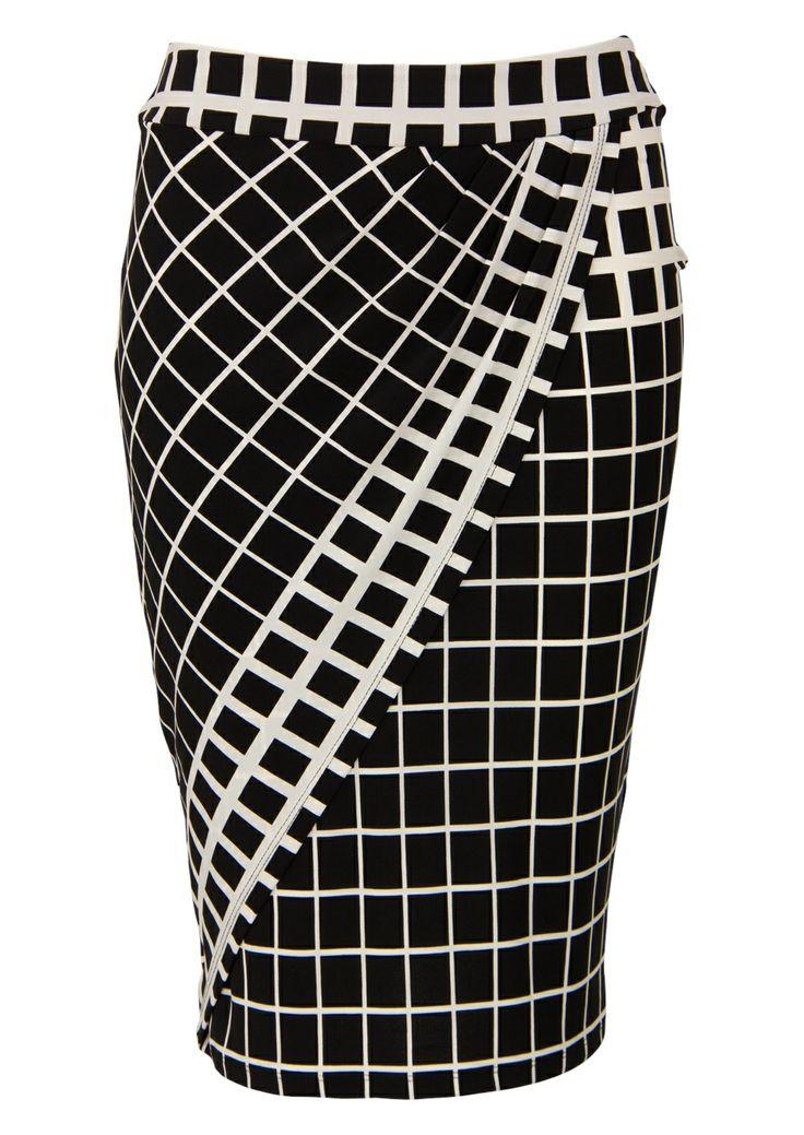Tweekleurige rok met blokjesprint. Het is een aansluitend model met veel stretch. Knielengte. Lengte in maat 38/M:60 cm.