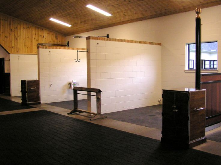Concrete block washgroom stalls with brick caps builtin rubber brick pavers  Barns Stables
