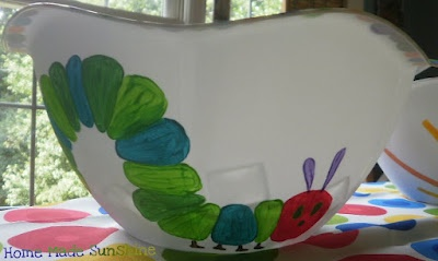 Another Dollar Store bowl painted (using craft paints) with the caterpillar from The Very Hungry Caterpillar to match the bowl with the sun for a birthday party