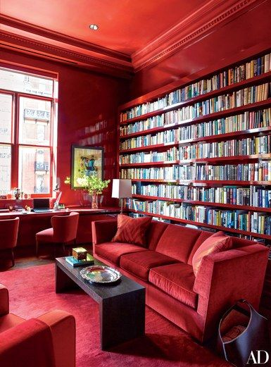 Designer Bruce Bierman turned a onetime Manhattan athletic club into a color-rich apartment. Lacquered bookshelves make a dramatic statement in the all-red library | archdigest.com