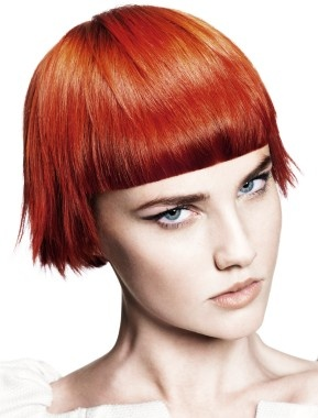 A short red straight coloured hairstyle by Mark Leeson