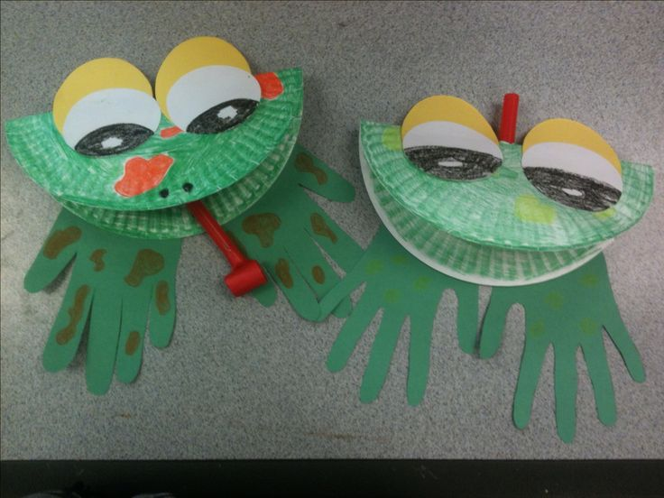 Frog craft made with paper plate, red party blowouts and handprints.
