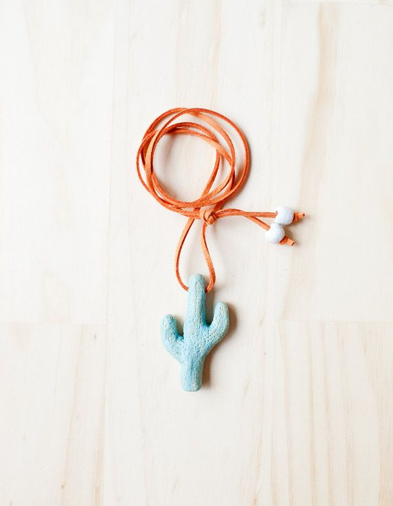 Hola mi amigo!  Youll love this fun green cactus necklace with hot tangerine orange synthetic suede cord. Youll be prickly if you dont get it :)