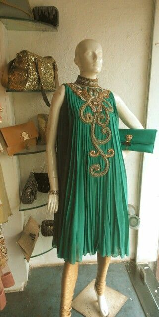 Indo-western outfit by Avesh Dadlani only at Jorss with tiger brooch clutch by Tanya seth.