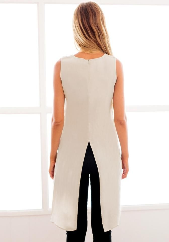 Back view of model in  pink asymmetric tank tunic