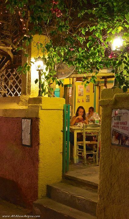 Having dinner in a traditional restaurant in the heart of Aegina town
