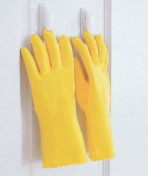 Hang Your Rubber Gloves    Problem: The insides of your rubber gloves are always damp, and they don't dry well hanging over the side of a bucket or the sink.    Solution: Glue clothespins to the inside of your broom closet or door, and clip the gloves by a fingertip to air-dry, open-side down. (If you don't want the pins permanently affixed, try 3M's removable Command Adhesive Spring Clips