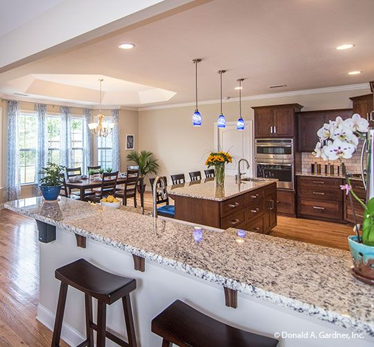 Bar seating offers an uninterrupted view of this beautiful kitchen and dining room. The Peyton - Plan 1289. http://www.dongardner.com/house-plan/1289/the-peyton. #Kitchen #OpenConcept #FloorPlan