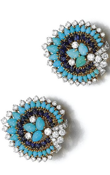 A PAIR OF TURQUOISE, SAPPHIRE AND DIAMOND EAR CLIPS, BULGARI The pair of ear clips  decorated to the centre with a pear-shaped motif in graduated lines of turquoise, cabochon sapphires and brilliant-cut diamonds, mounted in yellow gold and platinum, signed Bulgari.