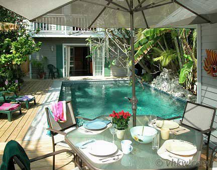 Key West Rentals - 6BR 5BA Sleeps 14 An Award Winning Villa and Caribbean Style Cottage side-by-side just 3.5 Blocks from Mallory Square. http://vacationhomesofkeywest.com/island-rendezvous-vacation-rental.html