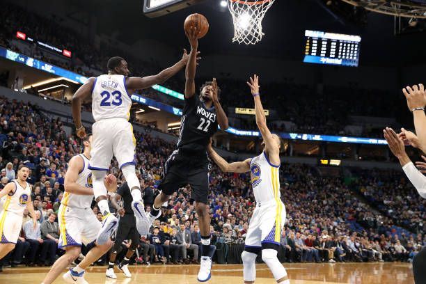 Andrew Wiggins of the Minnesota Timberwolves shoots a lay up during the game against the Golden State Warriors on March 10 2017 at Target Center in...