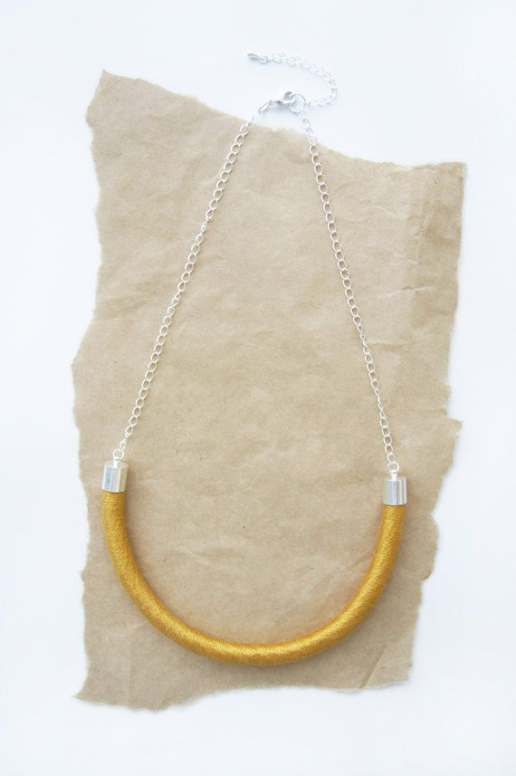 Wrapped gold necklace hand crafted with mercerised cotton thread and natural cotton rope.    Details  Silver plate metal parts  52cm around  5.5cm