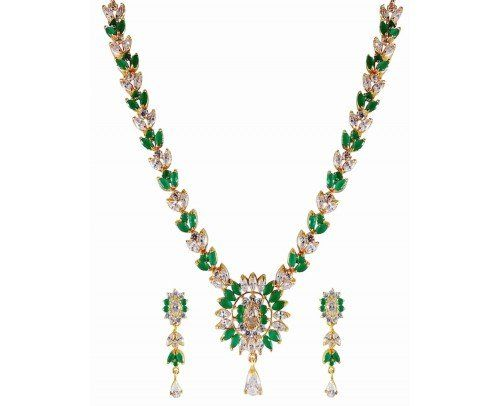 This timeless Treasure American Diamond Necklace Set from Rejewel is a Showstopper.This Bold ,Stunning piece with Necklace Set in Green colour CZ Stone from Rejewel is sure to get you noticed.Add charm to your attire.