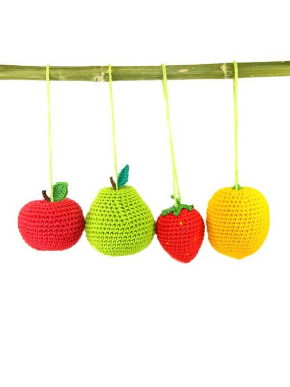 Funny toys for the little ones children made in the form colorful fruits. They can be fixed with a special loop on crib, stroller, the arc of the game pad or a deck chair baby. Also useful for playing the Garden & Horticulture, Kitchen, Shop and so on. This crochet and knit