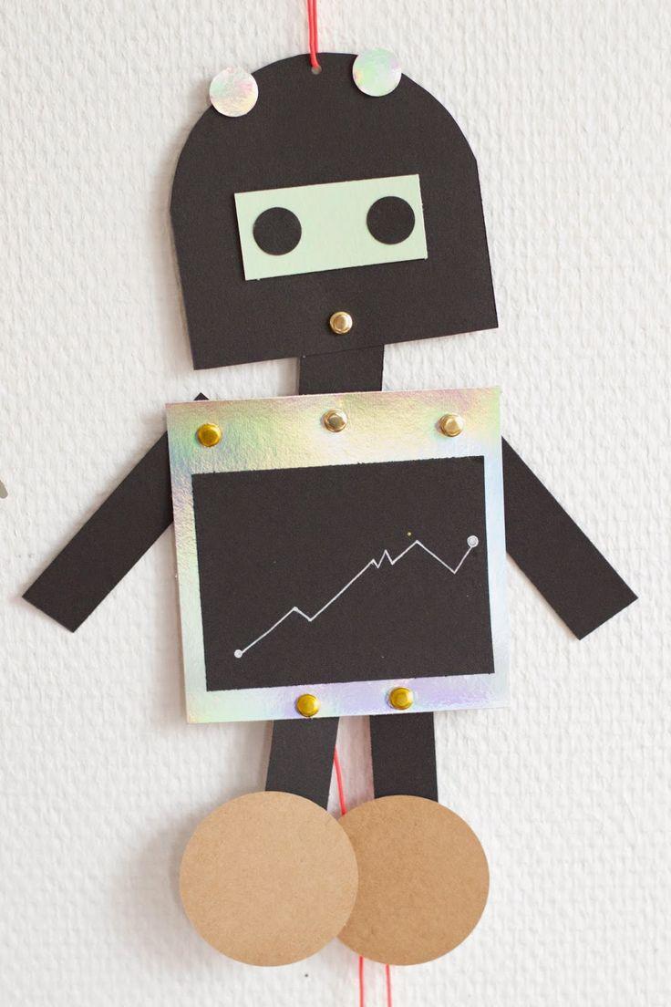 Trekpop robots zelf maken? Spiltpennen, gekleurd karton en een touwtje, aan de slag!