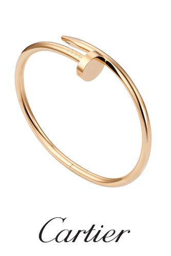 I'll just wait for the severely less-expensive knock-off.  But I do like it.  Cartier, Juste un Clou, $6250 (in pink gold).