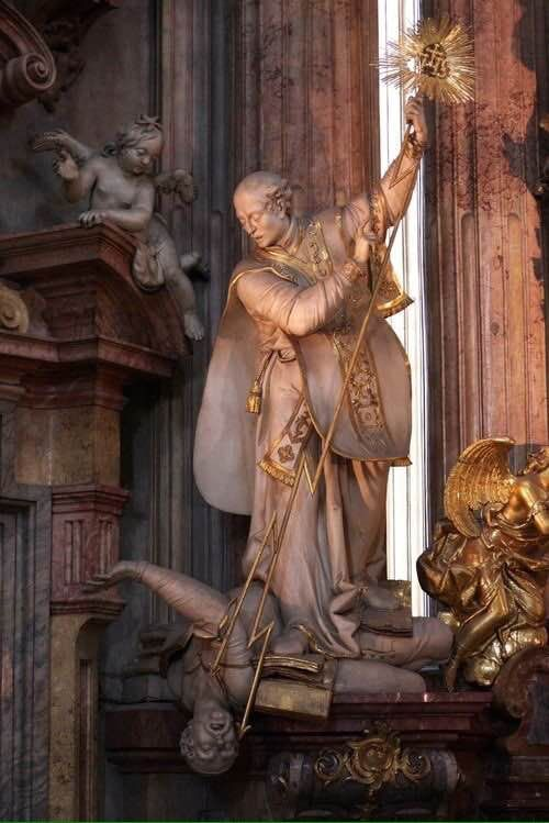 Statue of St. Ignatius of Loyola trampling on the heretic Martin Luther with the power of the Holy Eucharist. (Church of St. Nicholas, Prague) - Album on Imgur