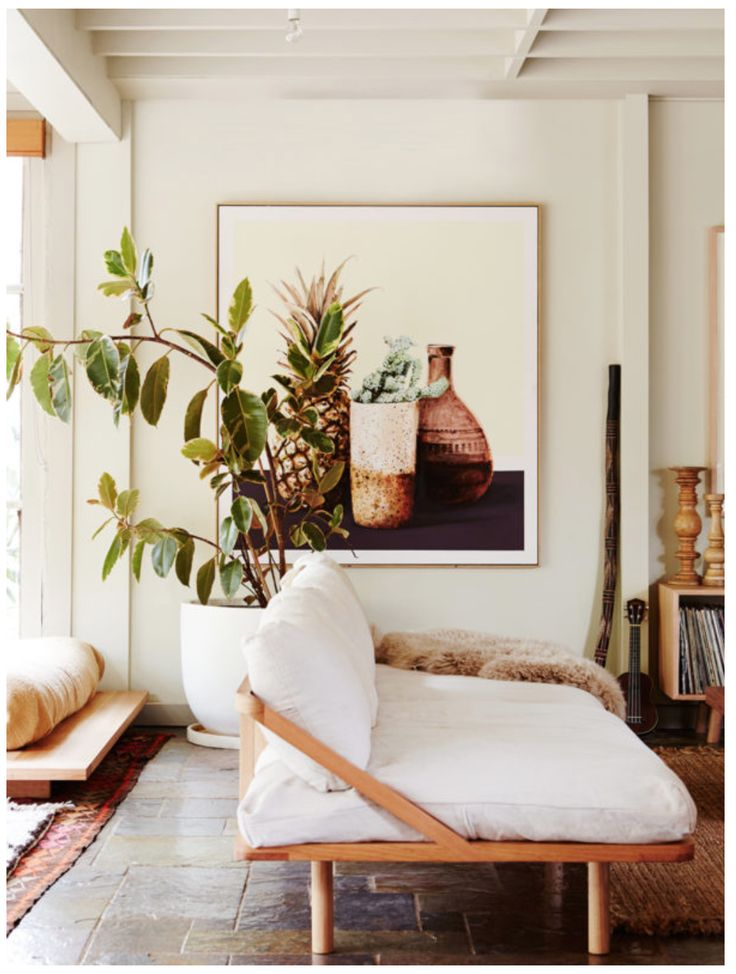 Achieve a modern bohemian living space with indoor plants, wood, and natural textiles