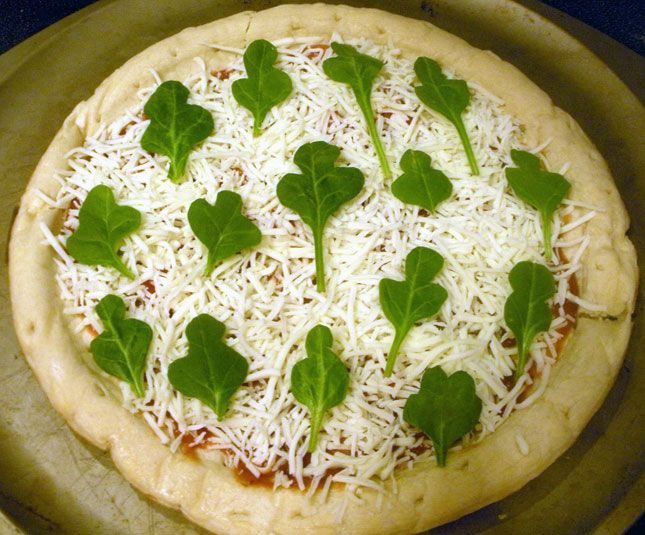 Spinach as shamrocks on your pizza. Yum! | St. Patrick's Day