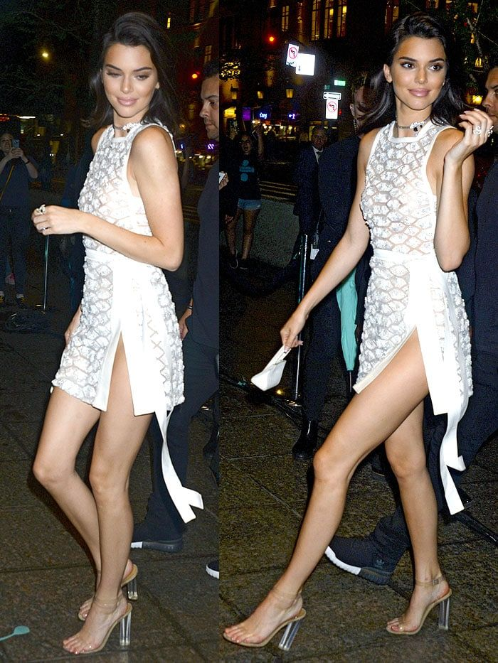 39eac9e2d1 Kendall Jenner in Yeezy Season 6 clear heels and an Elie Saab little white  dress.
