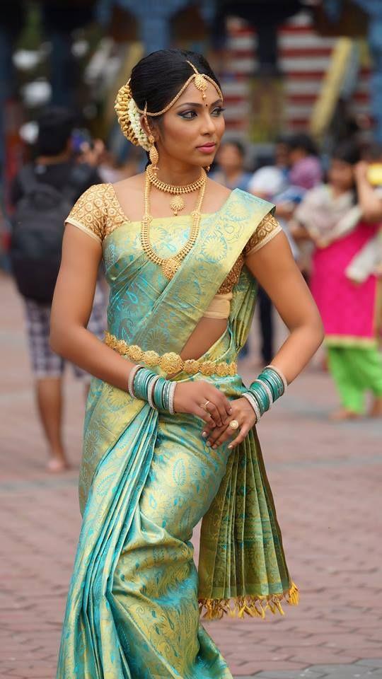 South Indian bride. Gold Indian bridal jewelry.Temple jewelry. Jhumkis.green silk kanchipuram sari.Braid with fresh flowers. Tamil bride. Telugu bride. Kannada bride. Hindu bride. Malayalee bride.Kerala bride.South Indian wedding.