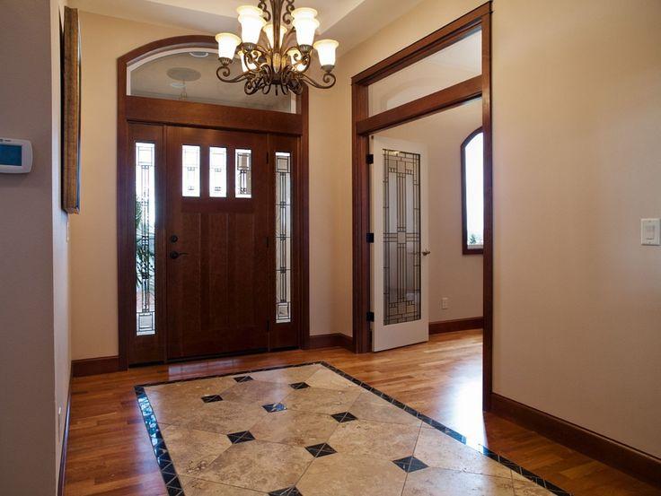 Craftsman Entryway with Chandelier, Glass panel door, Arched window, Laminate floors