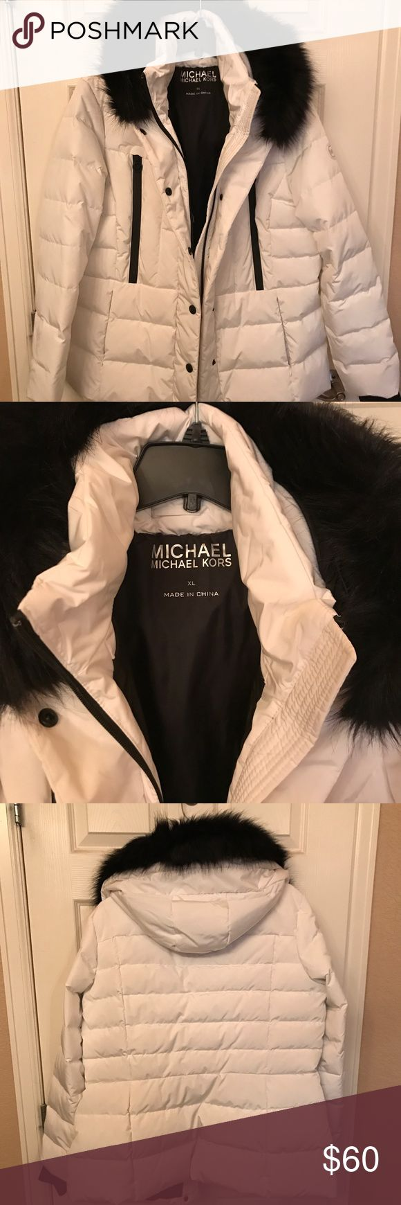 Michael Kors women's puffer coat Women's white puffer coat with hood a black faux fur trim.  The black fur trim is removable.  This coat does not have the tags on it but has only been worn one time.  It is essentially new.  This coat is really cute! MICHAEL Michael Kors Jackets & Coats Puffers