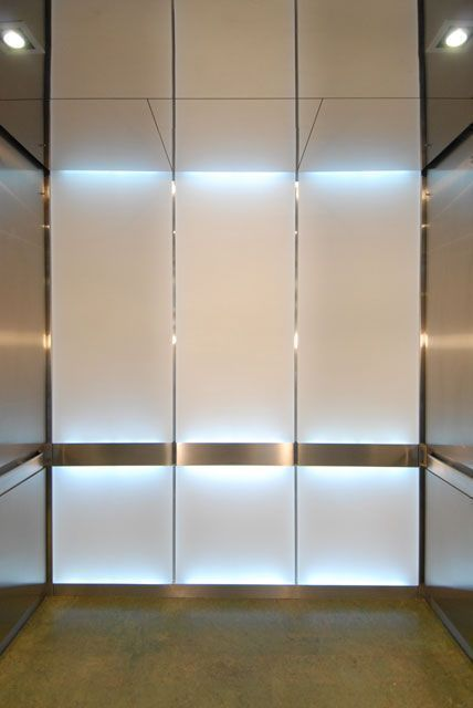back panels with accent lighting in handrail and behind panels; side panels of another material