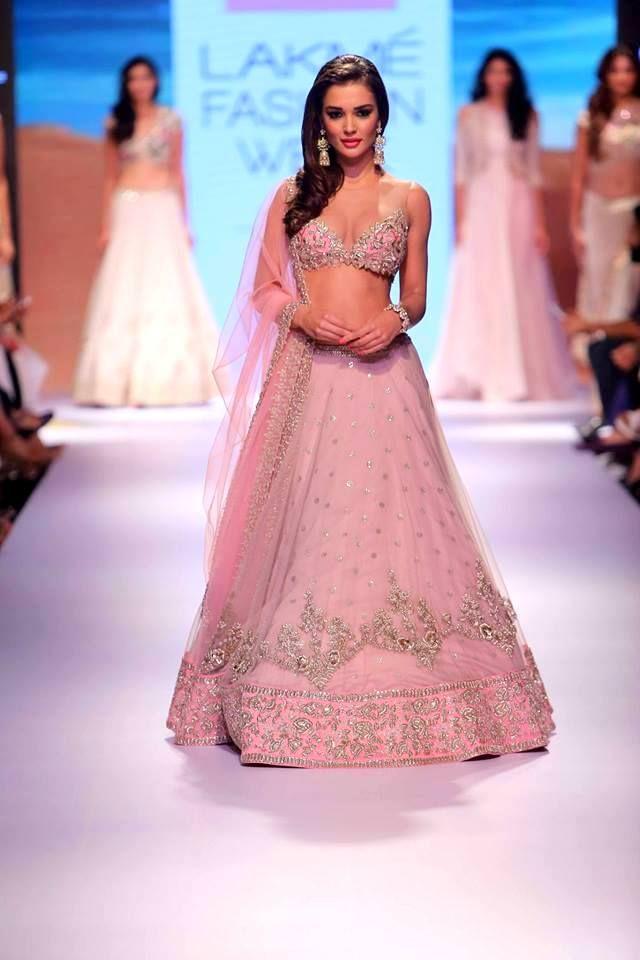 Exchange rings in this #romantic #AnushreeReddy #lehenga in pastel #pink at #LakmeFashionWeek #AW