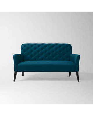 A tufted settee in cool peacock blue adds a shock of color to any living room. Buy it here: http://www.bhg.com/shop/west-elm-elton-settee-performance-velvet-lagoon-p504dec5382a7e3b7aaeaf256.html?socsrc=bhgpin101812shopwestelmbluesettee