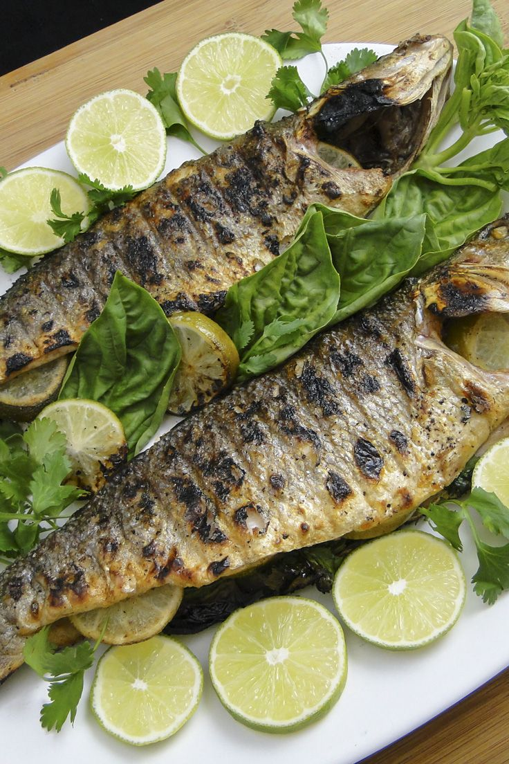 Grilled whole branzino stuffed with limes and herbs is super easy and fast, delicious and a great way to adhere to a healthy Mediterranean diet.