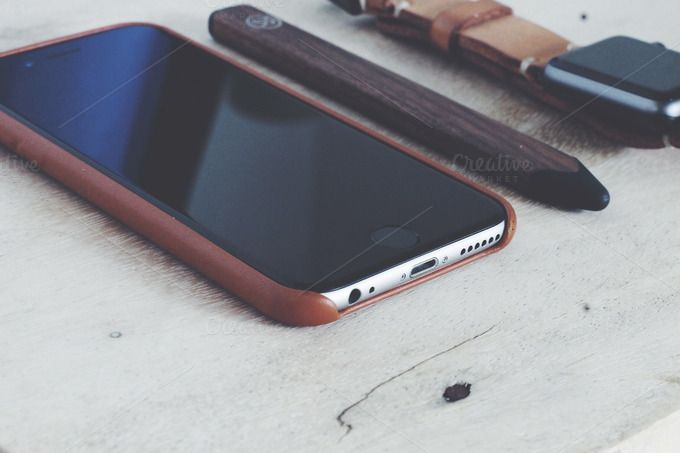 iphone 6 on a wooden desk by Addthisrock Studio on @creativemarket