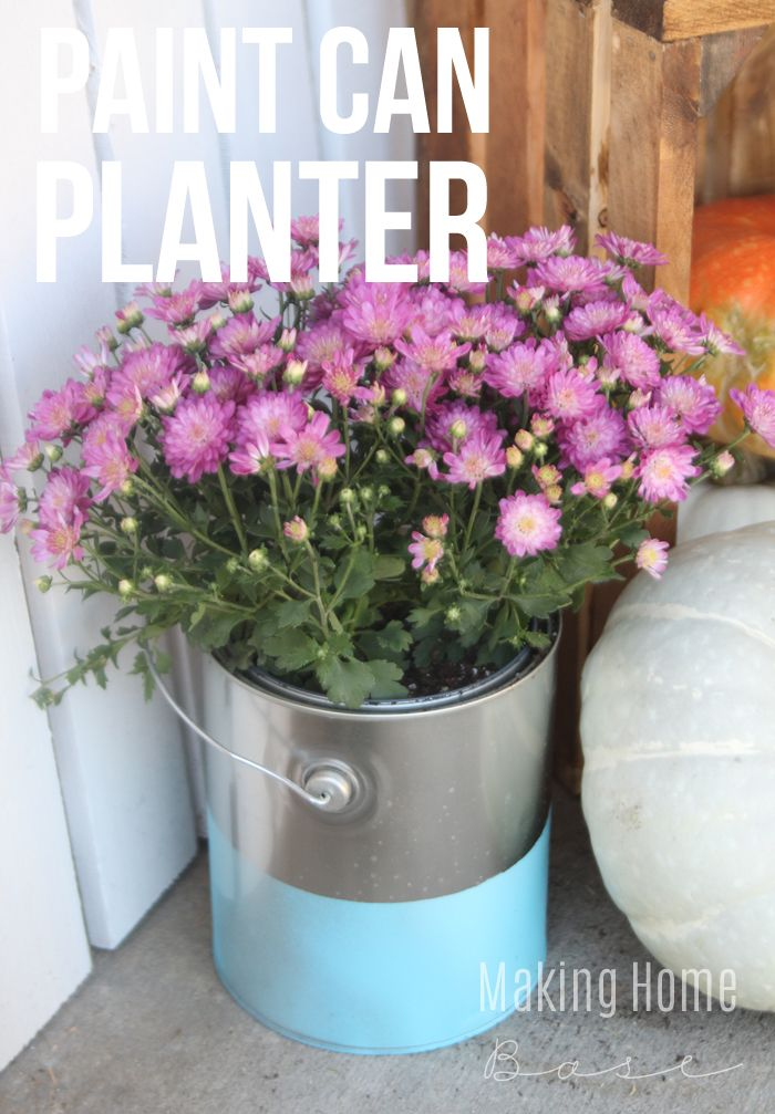 Paint Dipped Paint Can Planters - if you are looking for an alternative to traditional planters, here's a fun and inexpensive way to take your fall decor to the next level
