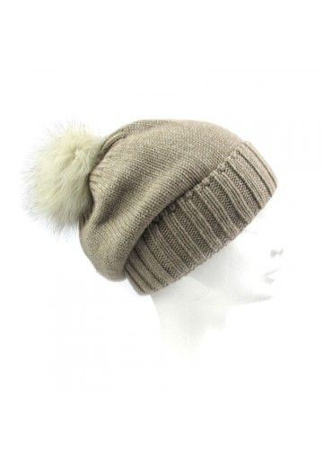 This nice warm bobble hat by Marini Silvano is for women. Simple knit pattern and genuine fox fur pompon feature the accessory. Available in 5 colours. The protagonist of the cold season.  #fashion #pompom #inverno