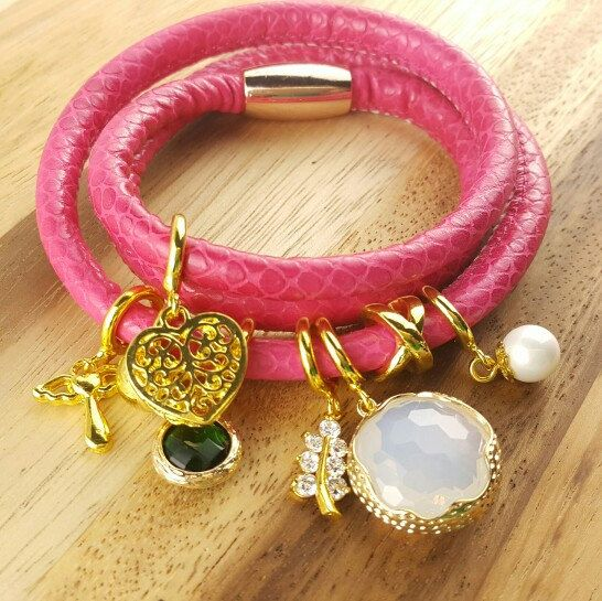 Endless leather bracelet 3 loop price at 12usd only and variety of charm cubic,pearl,birthstone staring at 1.5usd only...create your cool wrap bracelet at your choice.