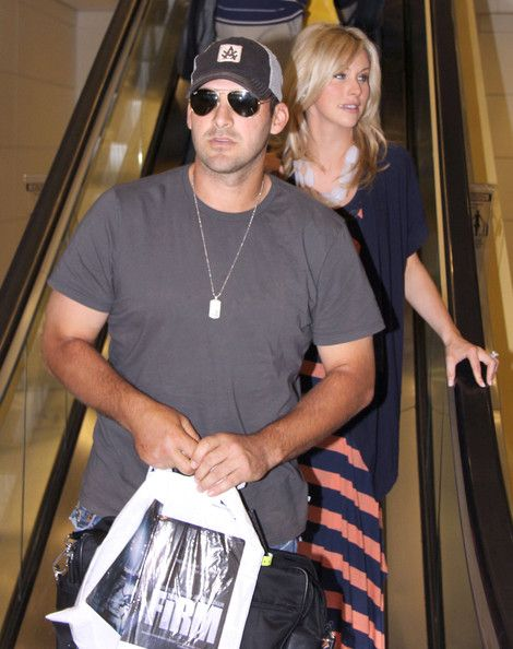 Tony Romo Photos Photos - Dallas Cowboys quarterback Tony Romo and wife Candice Crawford arriving on a flight at the Reagan National Airport in Washington DC on April 27, 2012. - Tony Romo And Candice Crawford Arriving In DC