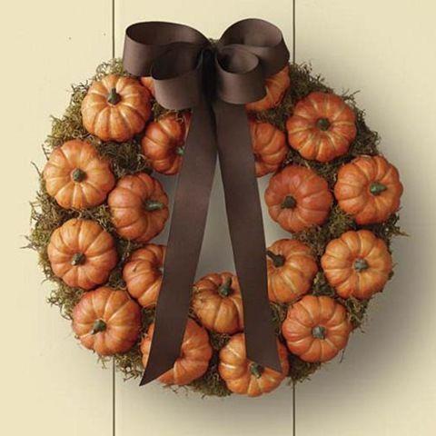 DIY wreath with moss/baby fake pumpkins/hot glue/spray adhesive/ribbon.