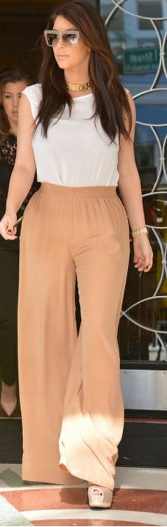 Kim: Pants – Kardashian Kollection    Pants – Chloe    Necklace and sunglasses – Celine
