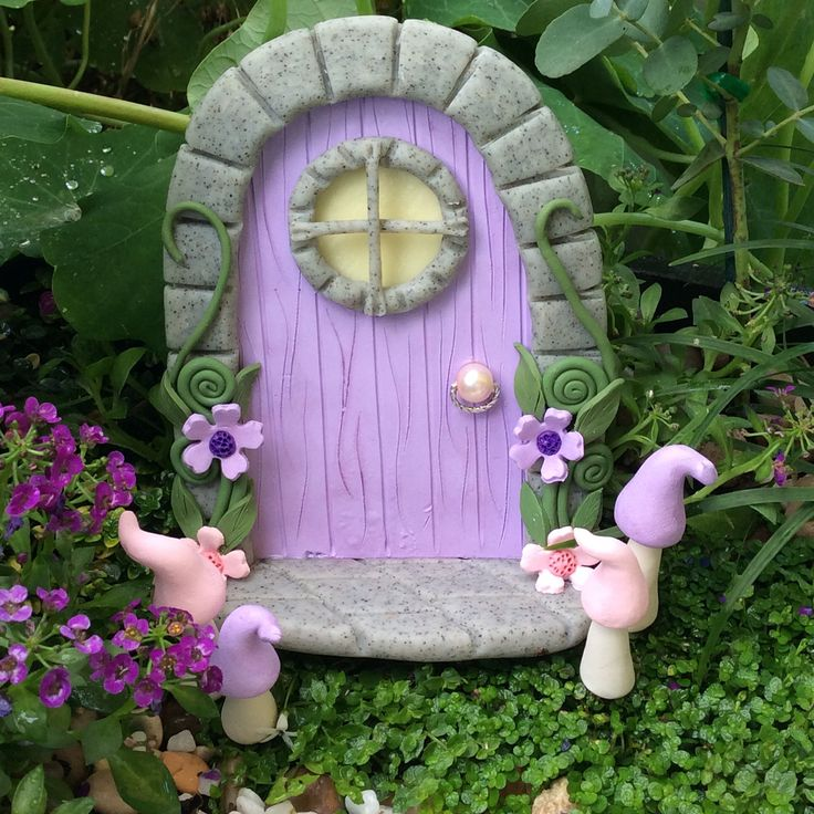 Polymer clay fairy door also available on our Etsy store. Door is sold with the mushrooms and has a glow in the dark window.