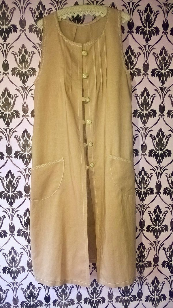 Ramie linen vest with decorative topstitching and shell buttons