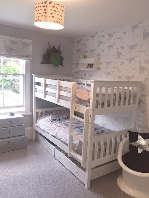 Thank you to Charlotte Vicente who has snapped & shared a gorgeous image of her son's new room. Charlotte cleverly made a blind from the 'D'ya-think-e-saurus' white & silver screen printed linen & teamed this with the coordinating wallpaper. We rather enjoy the dino head on the wall. A lovely touch. Though slightly! If you want to steal her style you can order the fabric & wallpaper here: http://www.paperboywallpaper.co.uk/