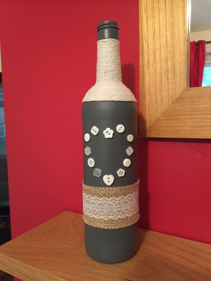 Grey spray painted bottle with string, lace and button heart decoration.. Love it