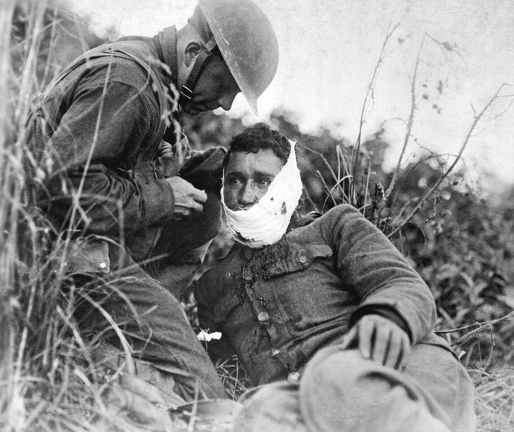 Soldier of Company K, 110th Regiment Infantry (formerly 3rd and 10th Infantry, Pennsylvania National Guard), just wounded, receiving first-aid treatment from a comrade. Varennes-en-Argonne, France. WW1, c. 1918 [National Archives, 2749 × 2309] : HistoryPorn
