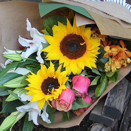 """Buy """"L`autumn"""" for $77.95. Send A Slice Of The South Of France Mixed With A Touch Of The South Pacific With This `autumn-esque` Bouquet Of Rustic Sunflowers, Fresh Peachy Roses, Lush Orchids & Lilies. Bright Yellow Sunflowers Add A Touch Of Country, While The Stems Of Exotic Perfumed White Oriental Lilies, Long Lasting Juicy Orange Orchids, And Sunset Coloured Roses Bring An Essence Of The Tropics Into The Mix. Send Flowers Online Or Call Our Helpful Consultants Toll Free. Order Before 1pm…"""