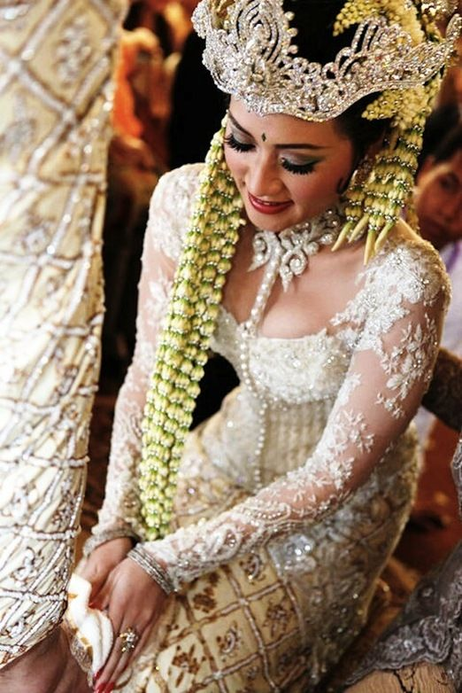 Sundanese bride. Nowadays even she the kebaya style differ to her preference, mandatory traditional Sundanese style of wearing siger (crown) etc is still preserved