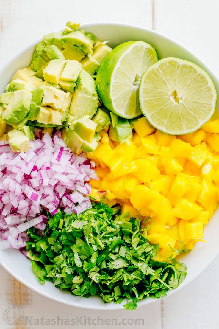 This sweet, chunky fresh mango salsa with avocado is excellent with chips or over tacos, chicken or fish. A 5-minute, 5-ingredient easy mango salsa recipe.