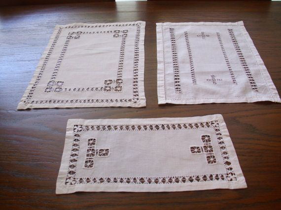 Three vintage rectangular white drawn work doilies. Beautiful work. The measurements for the three are 13 1/2 X 10; 14 X 10; and 11 1/2 X 6.